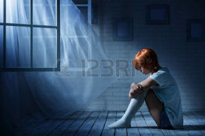 29528748-lonely-girl-sits-in-an-empty-dark-room-opposite-the-window